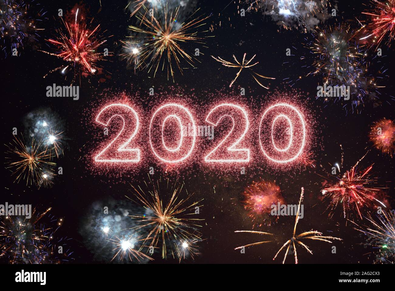 happy new year 2020 high resolution stock photography and images alamy https www alamy com 2020 year written with sparkle fireworks on night sky surrounded by fireworks of different colors happy new year 2020 greeting concept image336885531 html