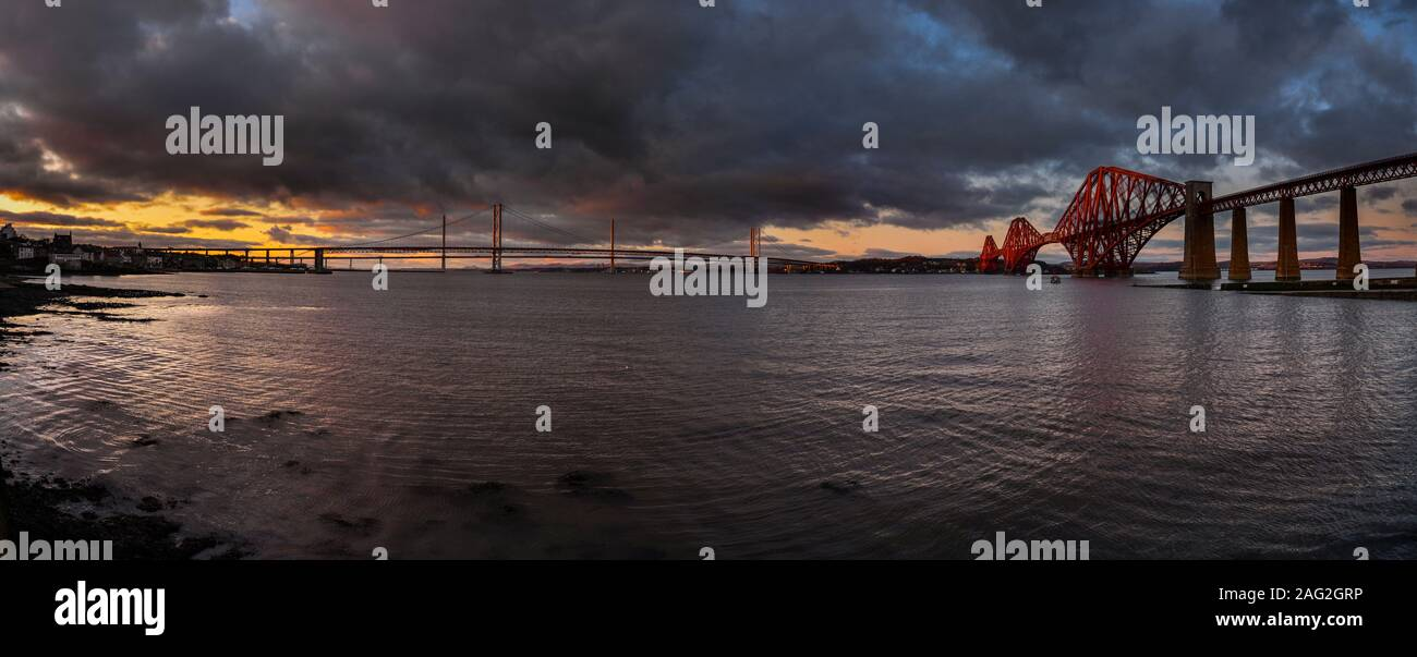 The Forth Bridges at sunset looking north across the Firth of Forth from South Queensferry Stock Photo