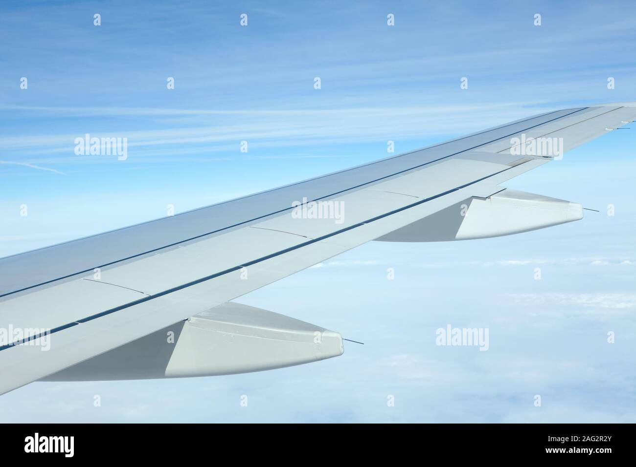 airplane wing during the flight Stock Photo