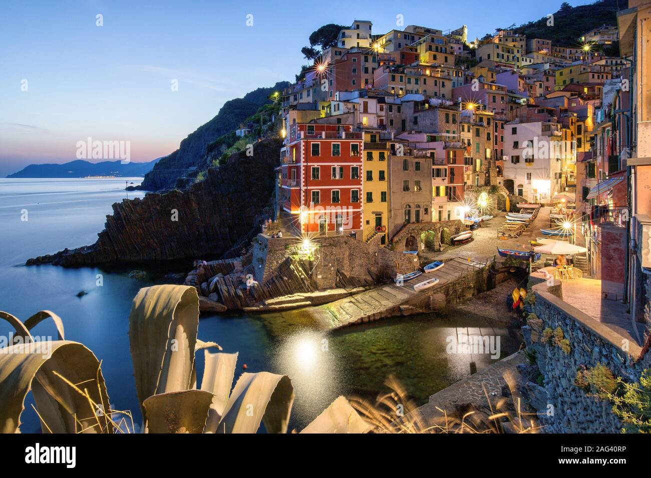 A beautiful high angle shot of the illuminated Cinque Terre sea Manarola Vernazza Rio Maggiore in Italy Stock Photo