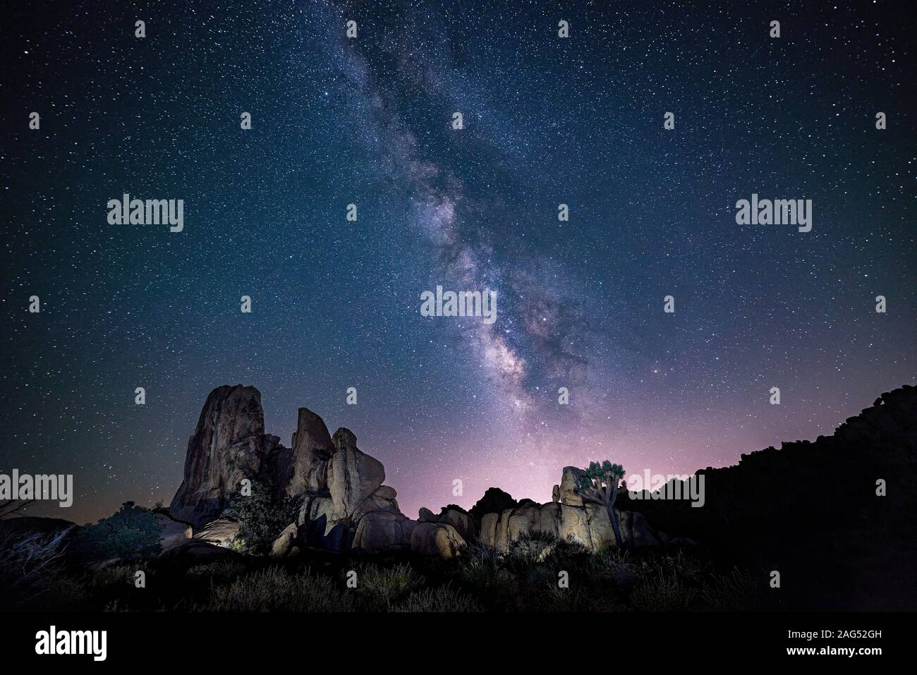 A Beautiful Shot Of Silhouettes Of Rocks Under The Purple Sky Full