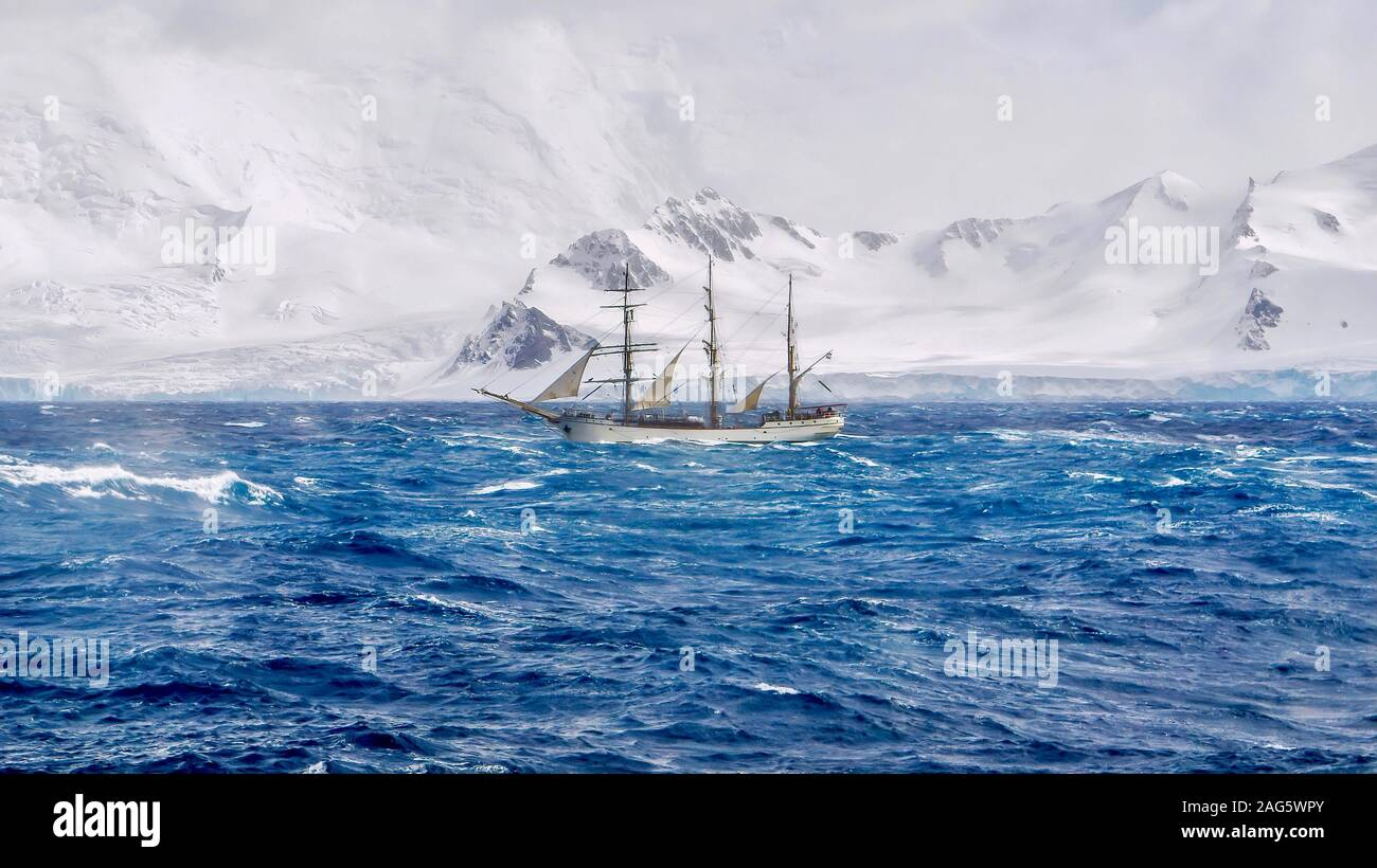 Extreme sailing conditions in Antarctica, as a three masted schooner sails south in a gale, passing the snow-capped mountains and glaciers of the Sout Stock Photo