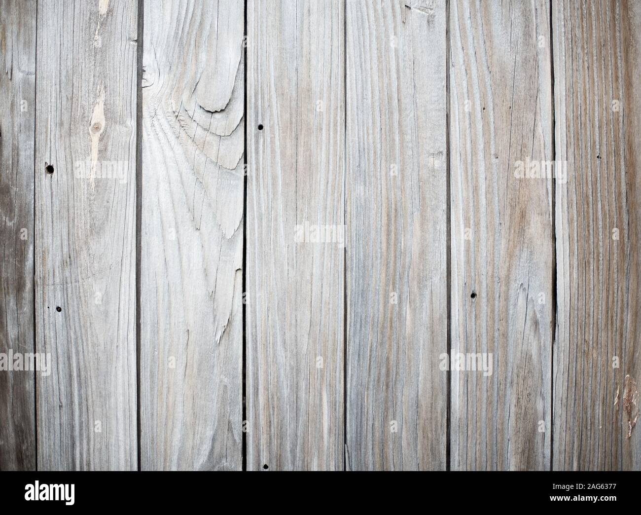 A Fence Made Of Vertical Wooden Planks Perfect For A Cool