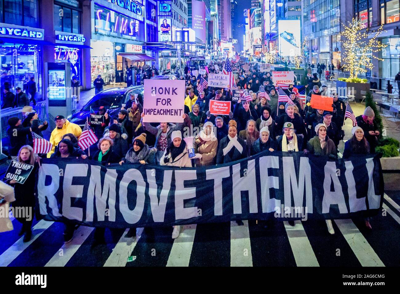 New York, New York, USA. 17th Dec, 2019. The night before the House of Representatives takes a somber vote to impeach Trump, hundreds of thousands of Americans joined the 'Nobody Is Above the Law' coalition at more than 500 rallies planned around the country, calling on the U.S. House to vote to impeach President Donald Trump. In New York City thousands of protesters took to the streets, gathering at Father Duffy Square in Times Square, and marched down Broadway to Union Square. Credit: Erik McGregor/ZUMA Wire/Alamy Live News Stock Photo