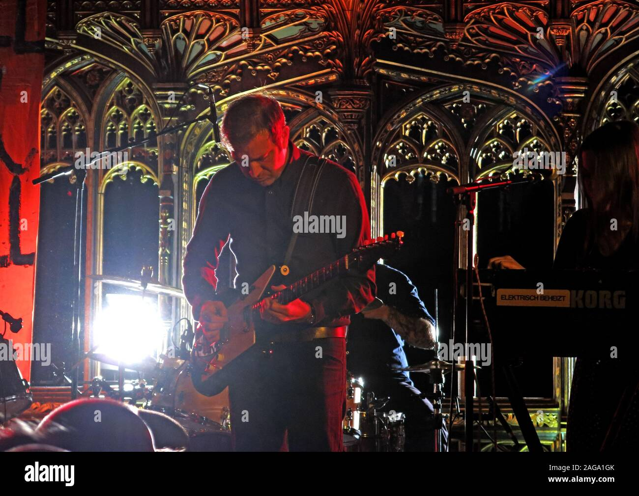 Mark E Smith & The Fall perform 15/05/2014 Manchester Cathedral gig - Pete Greenway Guitarist Stock Photo