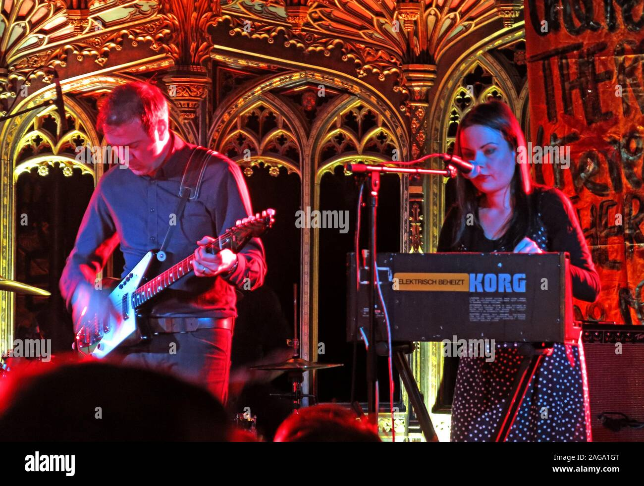 Mark E Smith & The Fall perform 15/05/2014 Manchester Cathedral gig - Pete Greenway Guitarist & Elena Poulou Stock Photo