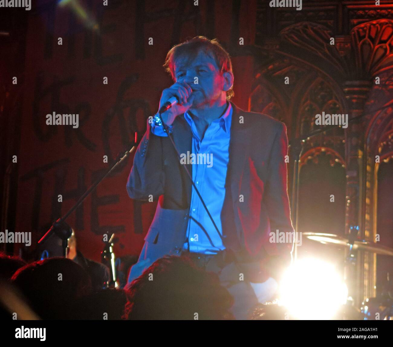 Mark E Smith & The Fall perform 15/05/2014 Manchester Cathedral gig - MES on vocals with microphone Stock Photo
