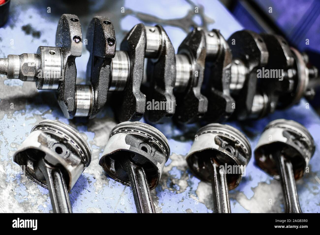 crankshaft and pistons with connecting rods of an internal combustion engine on a table Stock Photo