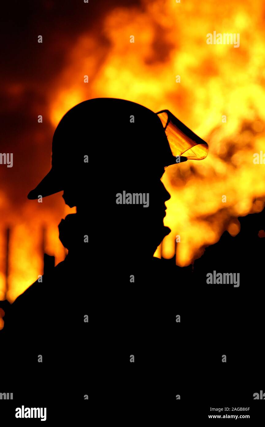 fire-fighters fighting wildfires, Australia Stock Photo