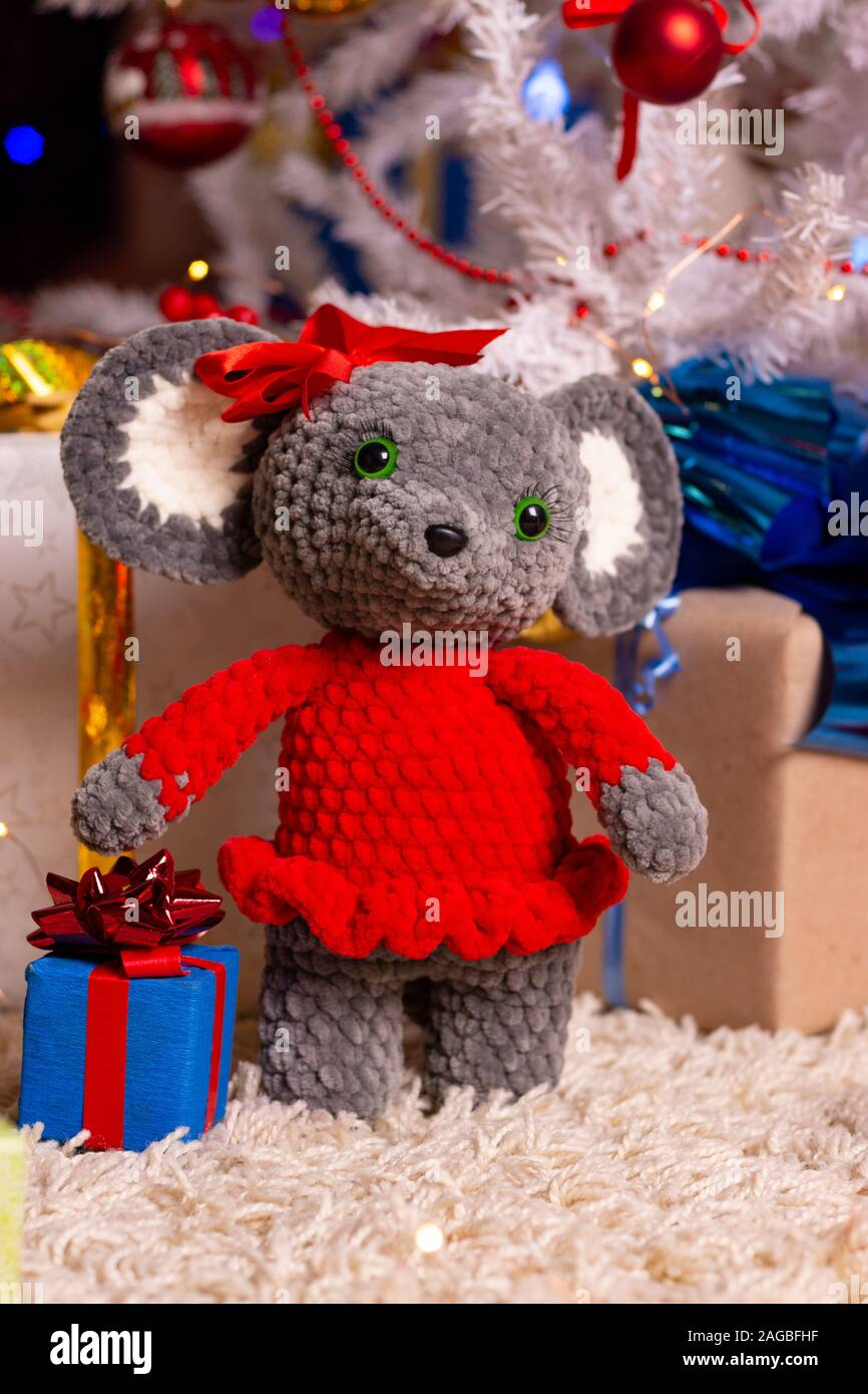 Plush toy mouse girl on New Year's background Stock Photo