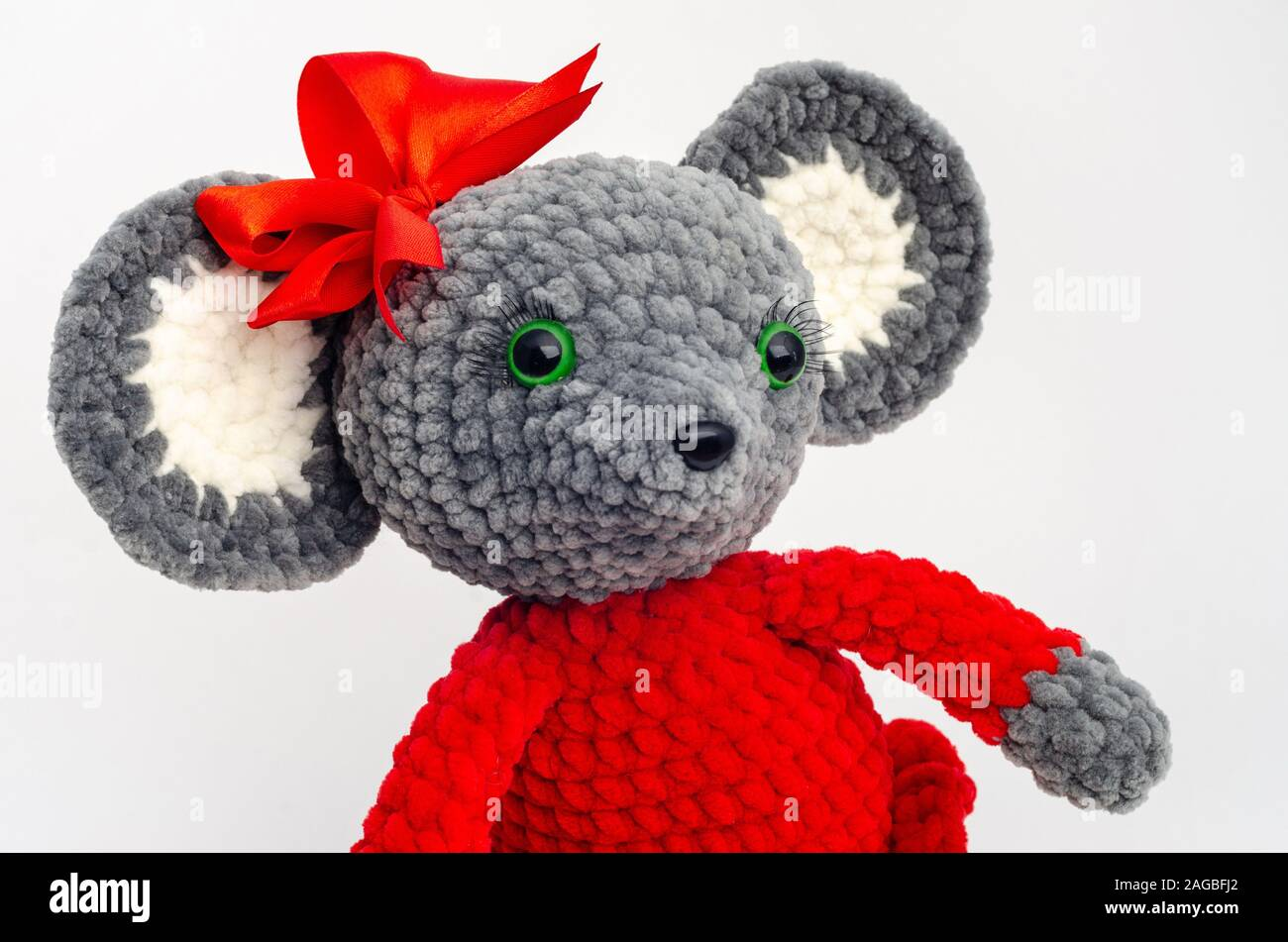 Portrait of a teddy mouse with a red bow on its head Stock Photo