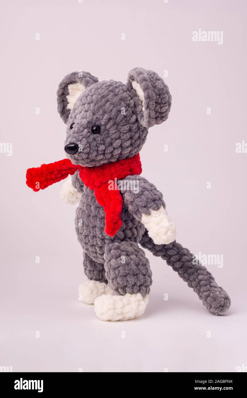 Funny knitted teddy mouse, Side view, white background Stock Photo