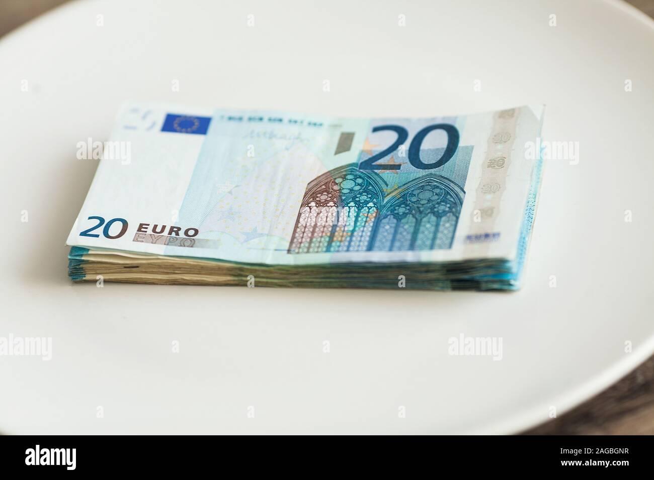 Money lying on the plate. Euros photo. Greedy corruption concept. Bribe idea. Stock Photo