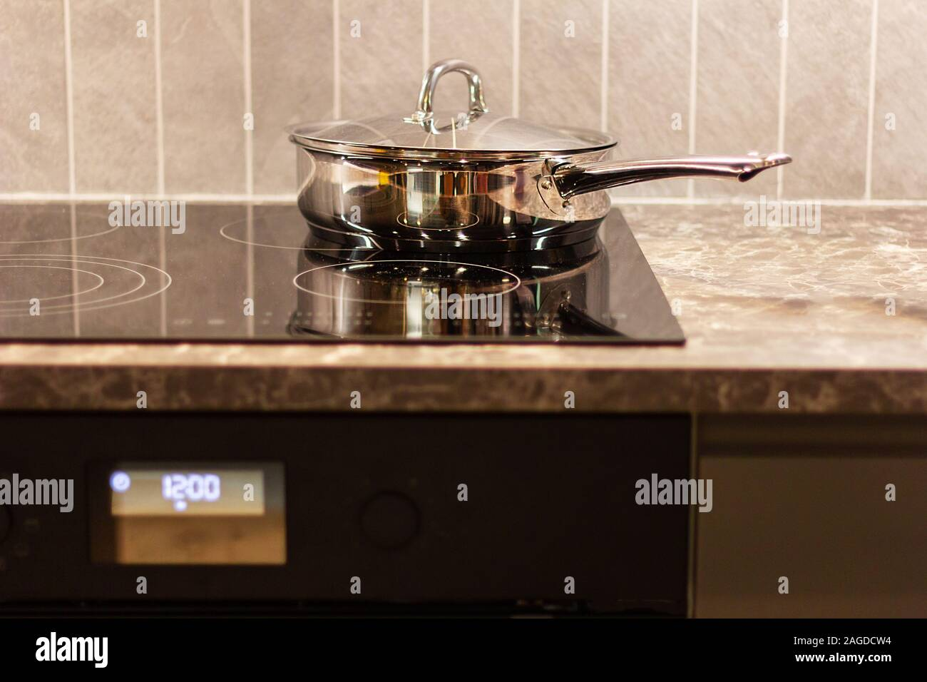 chrome pan on electric stove . kitchenware accessories Stock ...