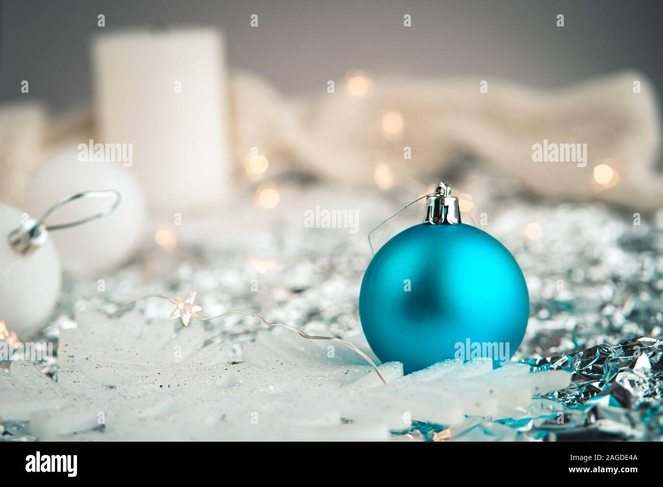 White And Blue Holiday Decorations On Silver Background Christmas Balls And Fairy Lights Color Of The Year Concept Stock Photo Alamy