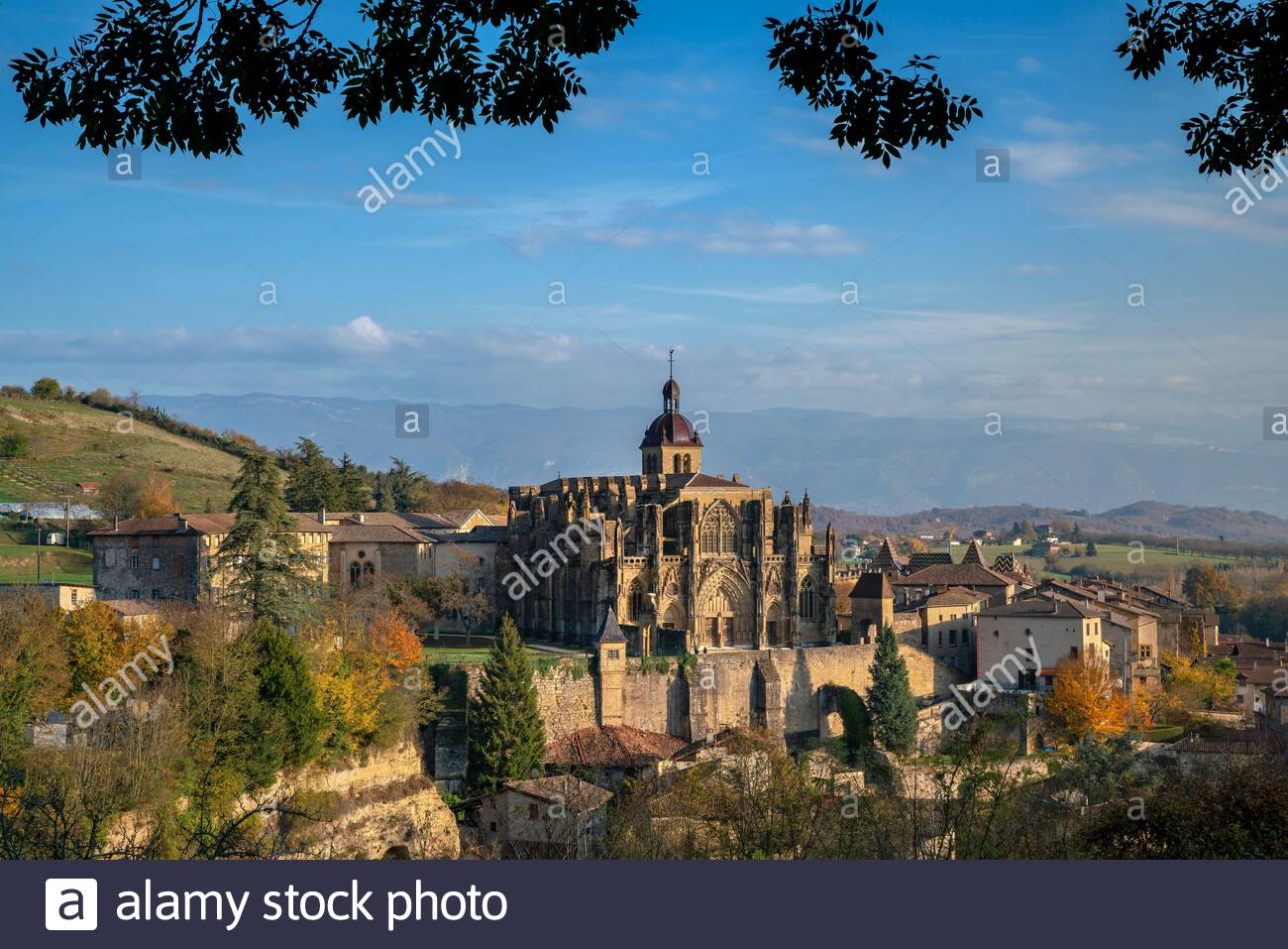 Saint-Antoine-l'Abbaye in Isère (France) : the Abbey church and the village in late afternoon Stock Photo