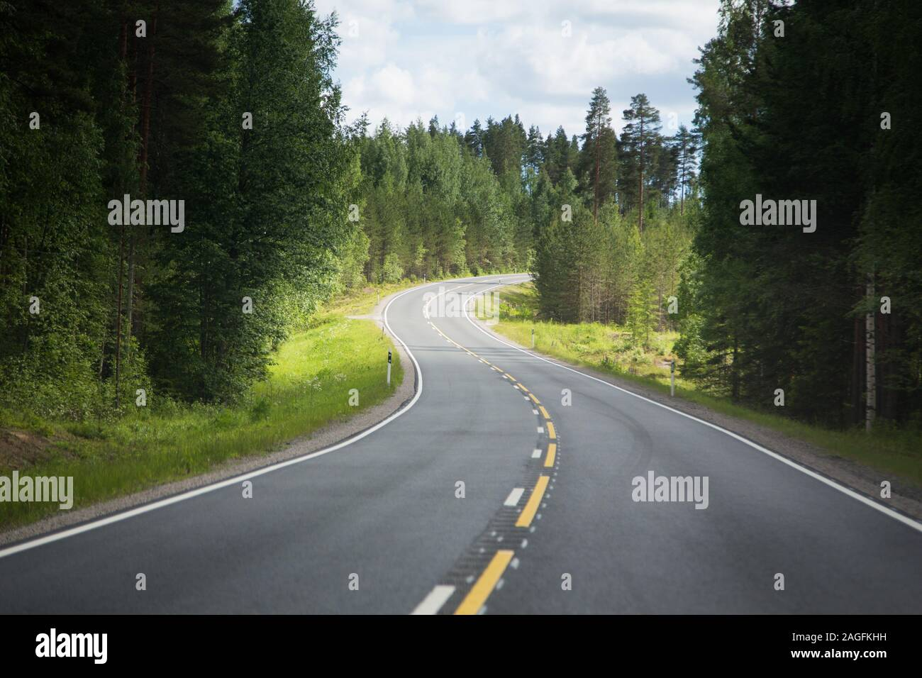 Paved strech of a country road leading into the distance Stock Photo