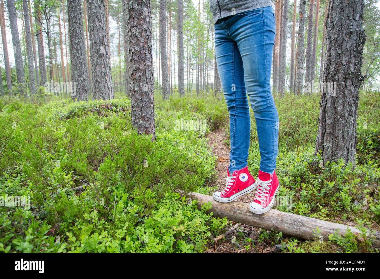 Converse All Star trainers in bright colour worn by a young female Stock Photo