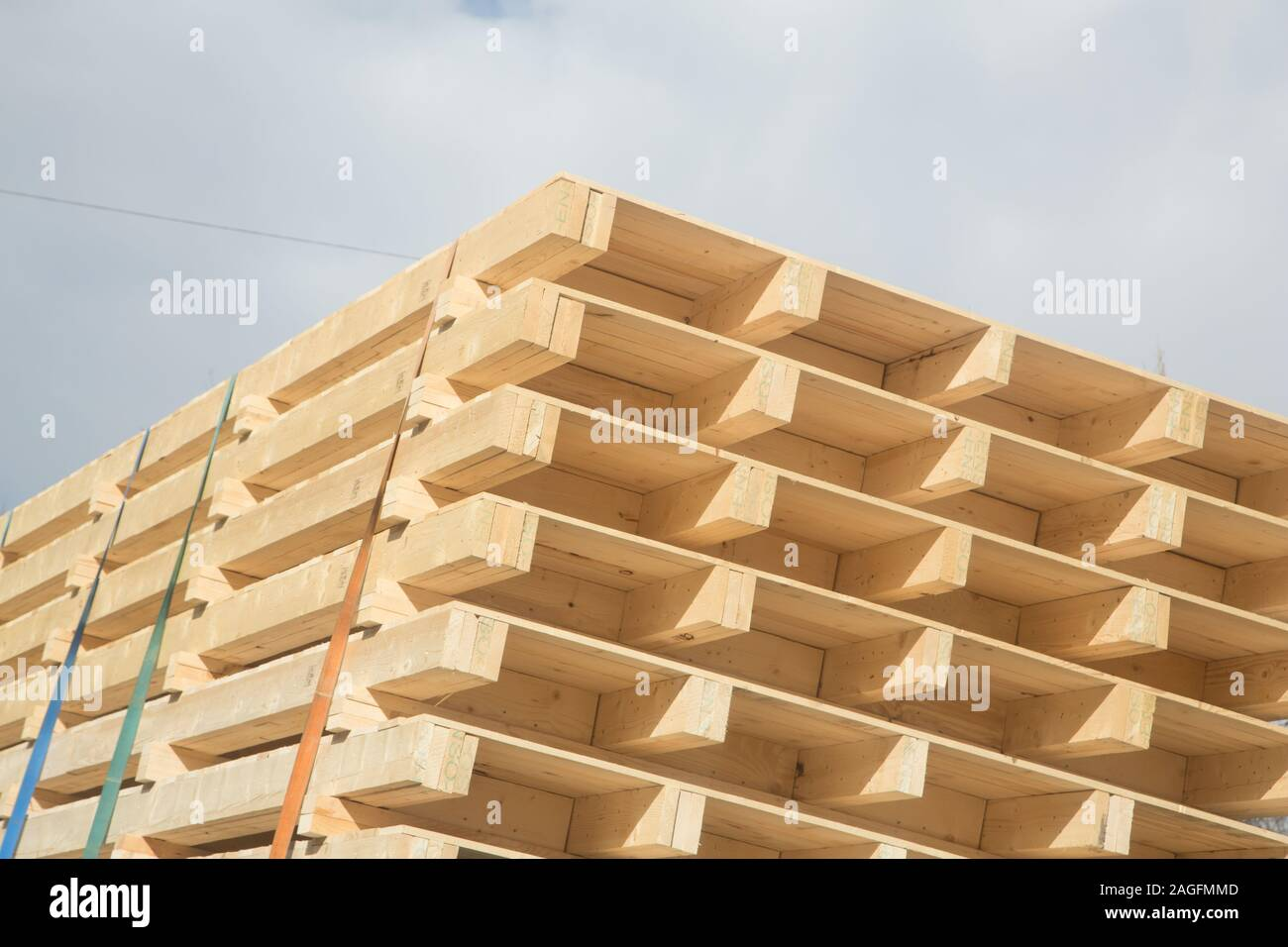Wooden building elements loaded on a truck in traffic Stock Photo