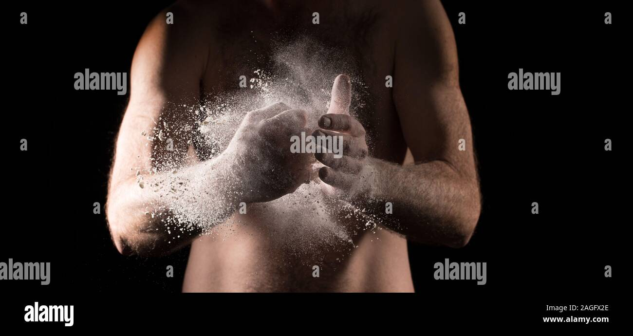 Box and fight, Boxer rubbing powder in hand for grip, Hand of boxer over black background , punching hand, fist , fast punch Stock Photo