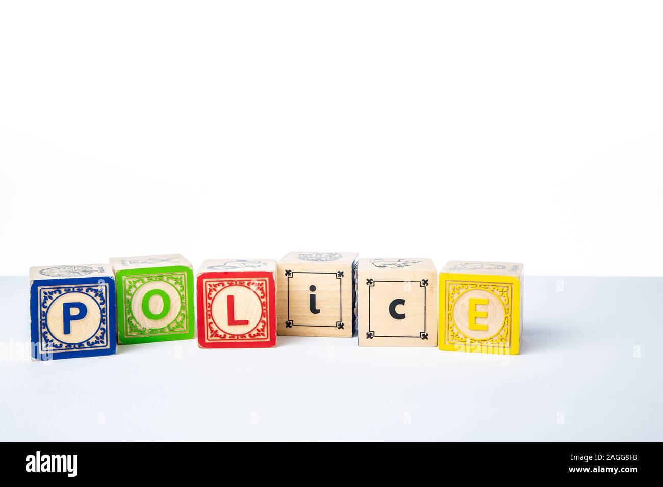 Childrens Wooden Alphabet Blocks Spelling the Word Police Stock Photo
