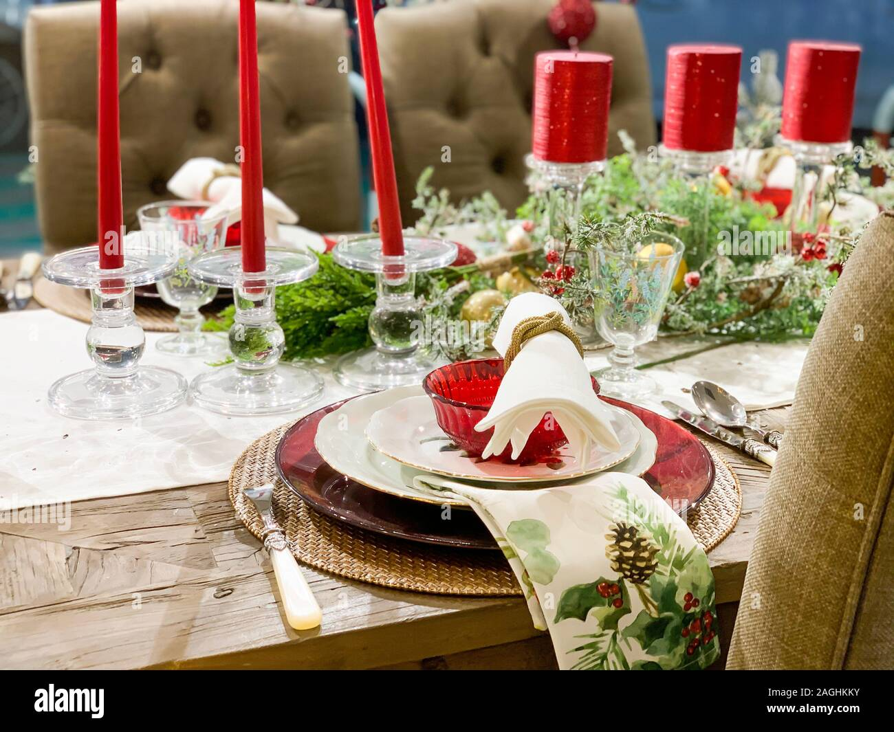 Elegant Christmas Dinner Table Decoration With Dishes Glasses And Candles Stock Photo Alamy