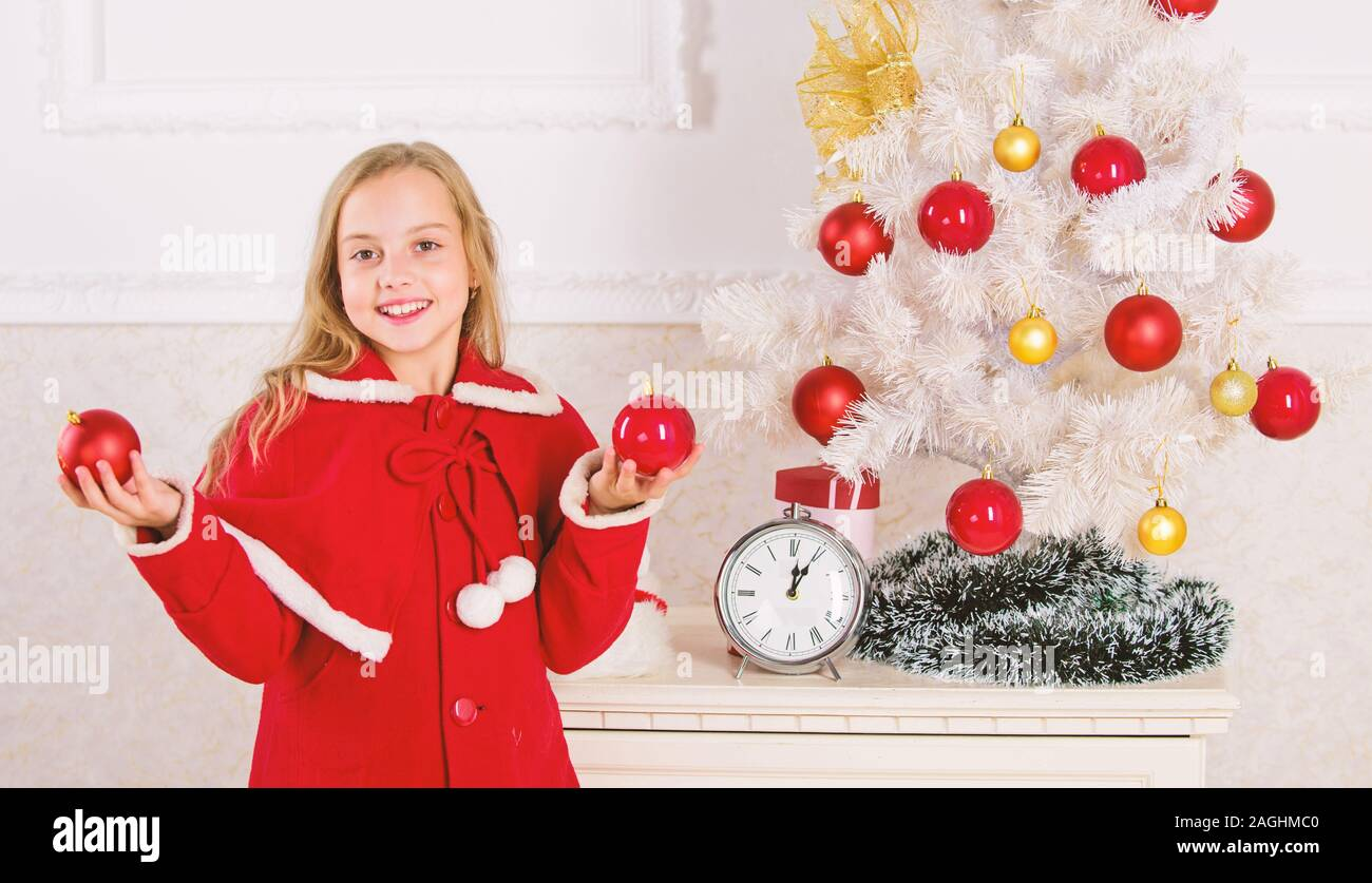 Child Red Costume Hold Christmas Ornament Ball Christmas Ball Traditional Decor Top Christmas Decorating Ideas For Kids Room Kids Can Brighten Up C Stock Photo Alamy