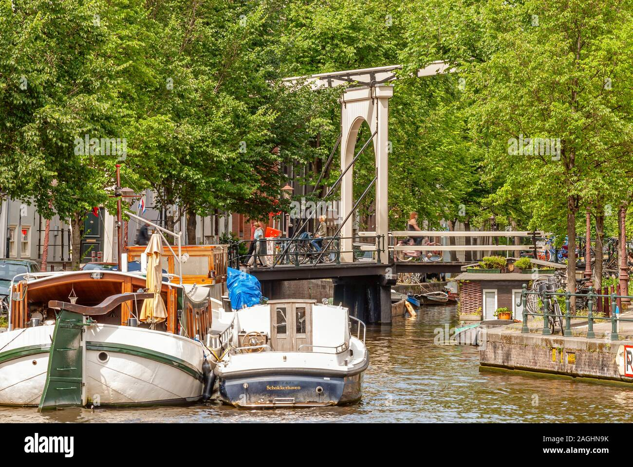 House boats in a water channel in the city center of Amsterdam, Netherlande Stock Photo