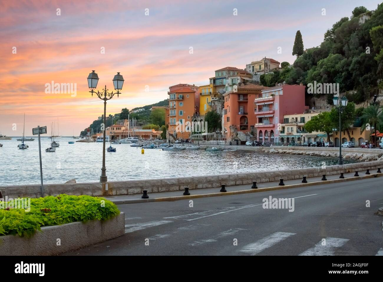 A colorful sunset on the Cote d'Azure at the seaside town of Villefranche Sur Mer, France, on the French Riviera. Stock Photo