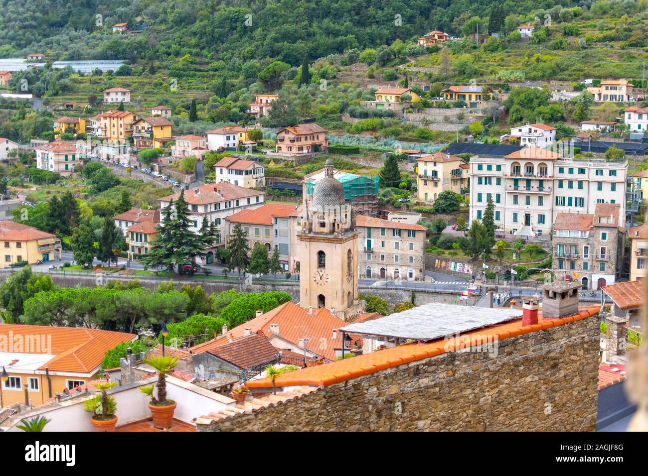View of the Medieval Church of Saint Anthony clock tower and city of Dolceacqua, Italy, from the ancient hilltop castle. Stock Photo