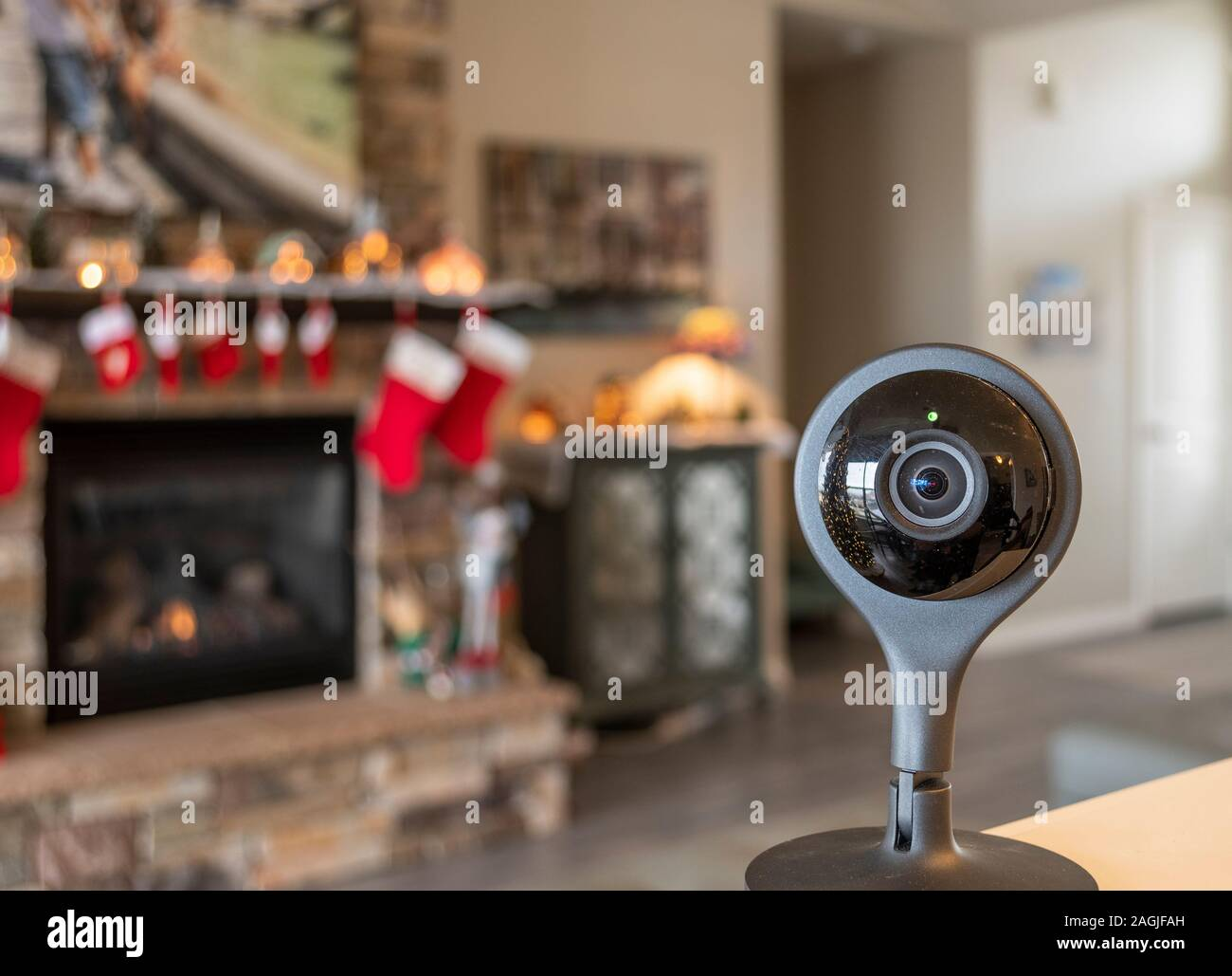 A security camera with the light on in front of an interior living room of a home at Christmas time. Stock Photo