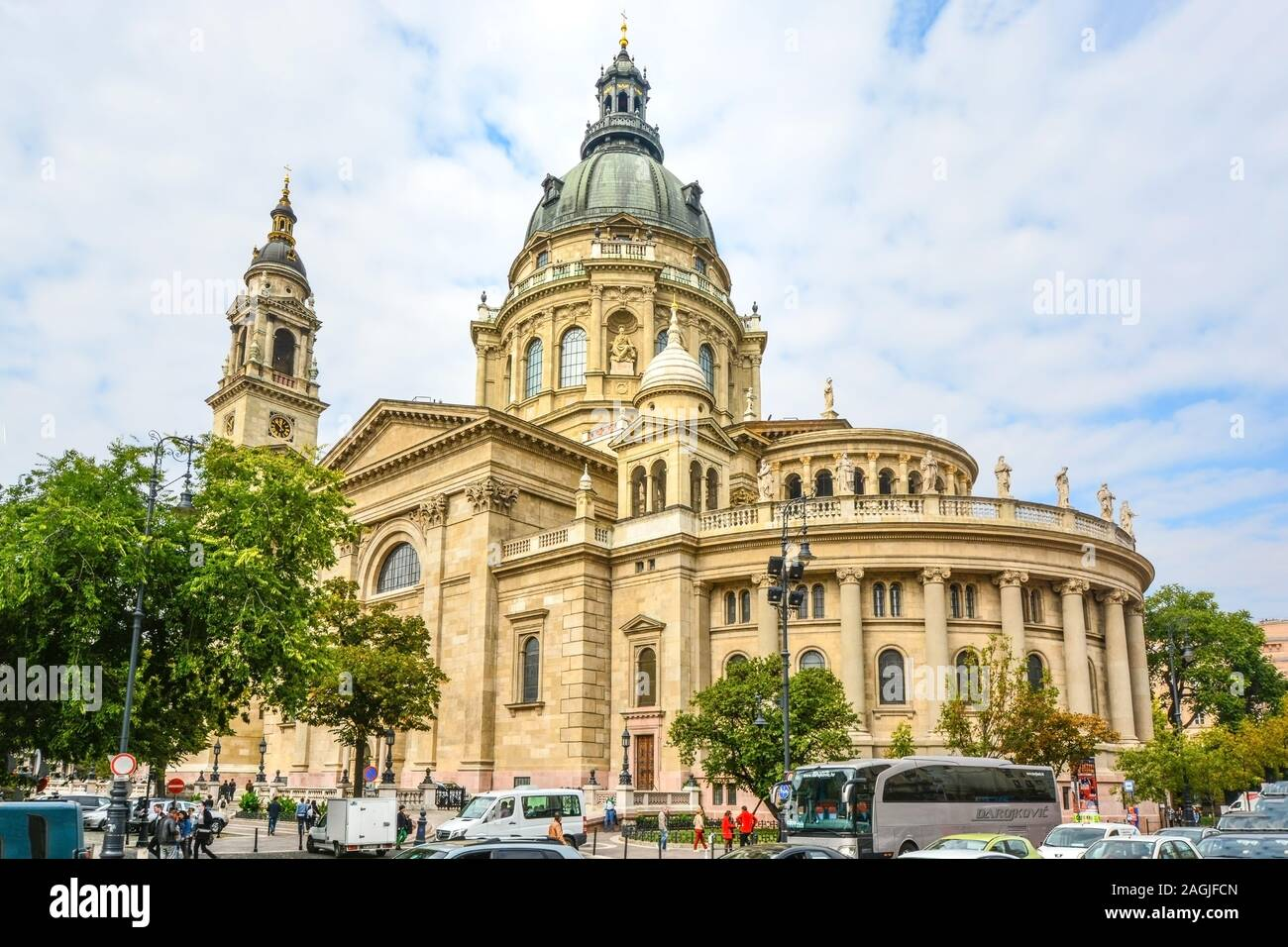 September 28 2018: Tourists and local Hungarians pass by St. Stephen's Basilica, a Roman Catholic basilica in Budapest, Hungary Stock Photo