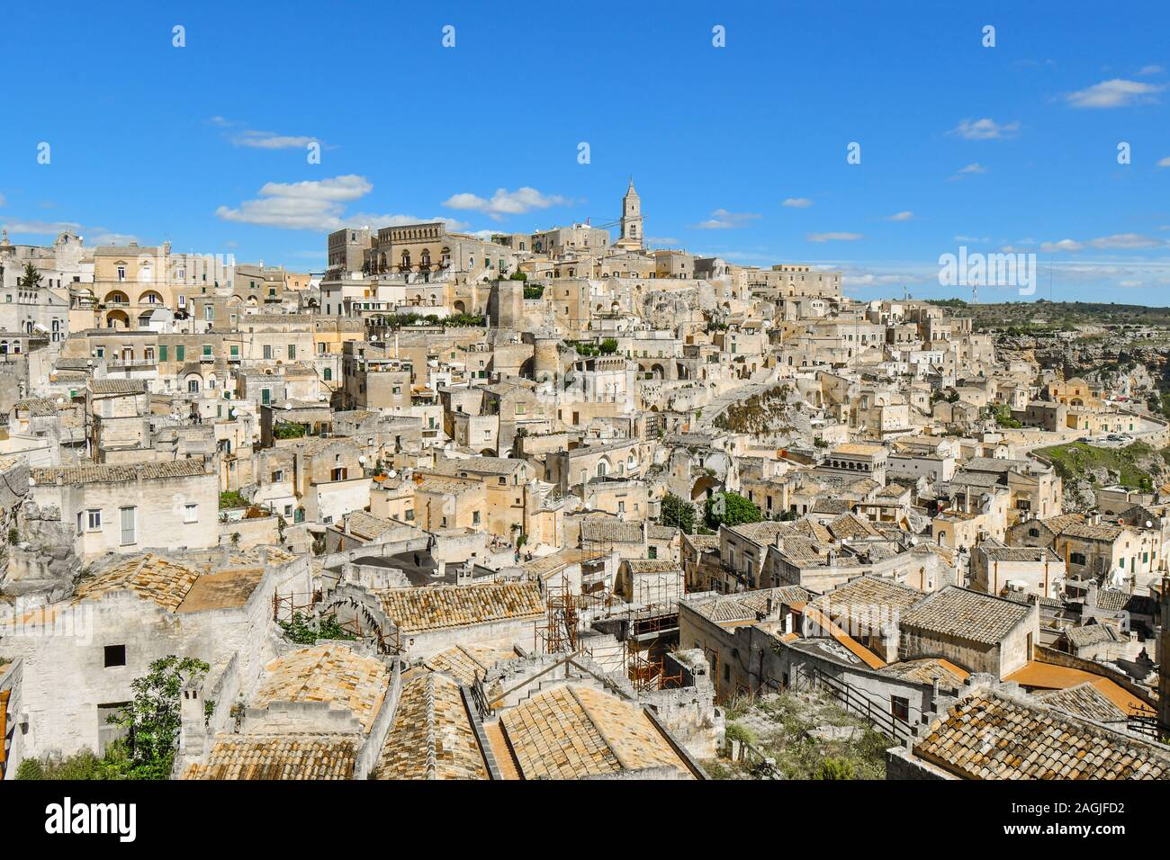 View of the ancient skyline and village of Matera, Italy, including the Matera Cathedral, in the Basilicata region of Italy. Stock Photo