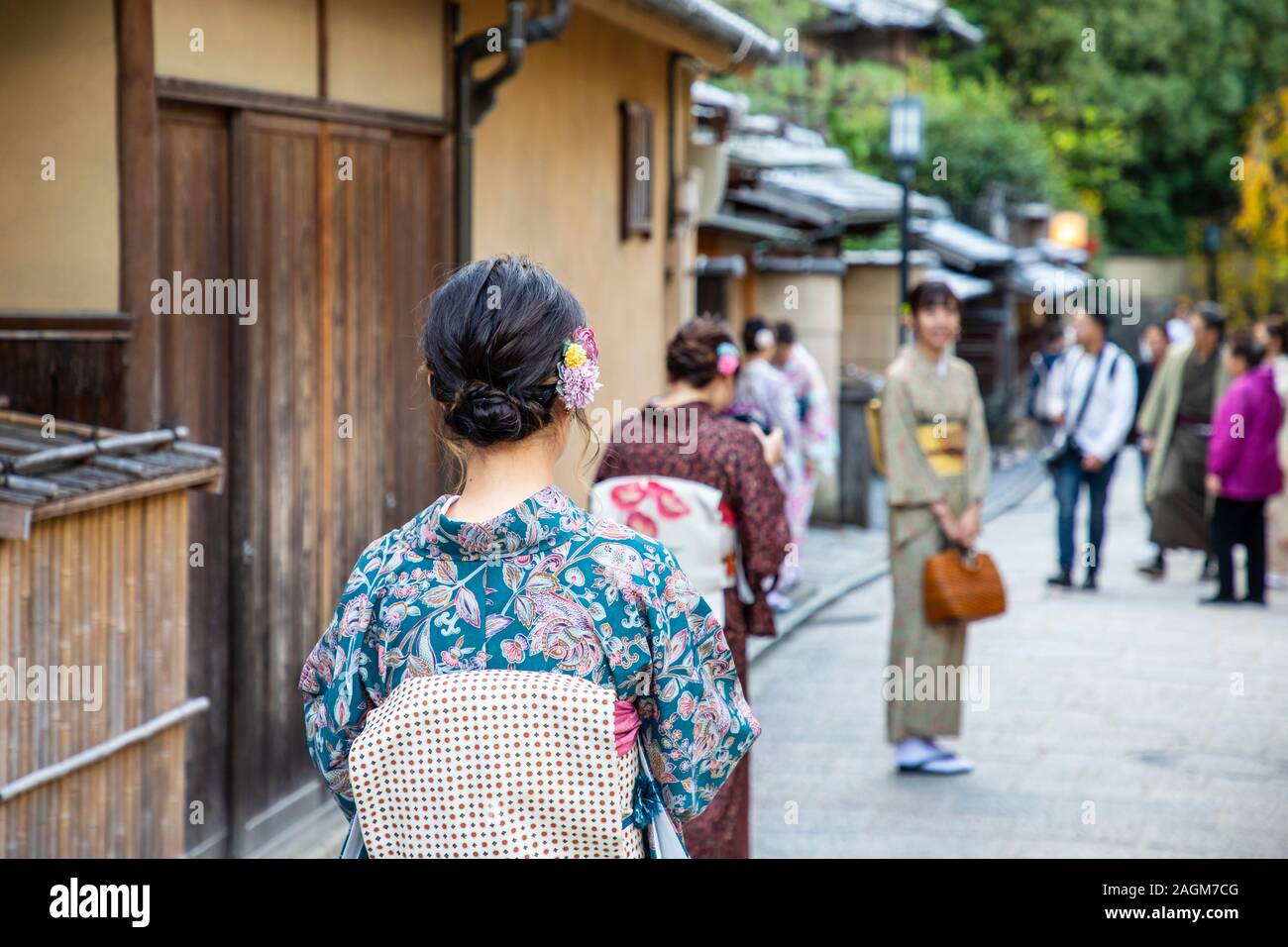 KYOTO, JAPAN -17th  November 2019:Tourists dressed in traditional kimono visit Ninezaka and Sannenzaka iconic streets  lined with old wooden buildings Stock Photo