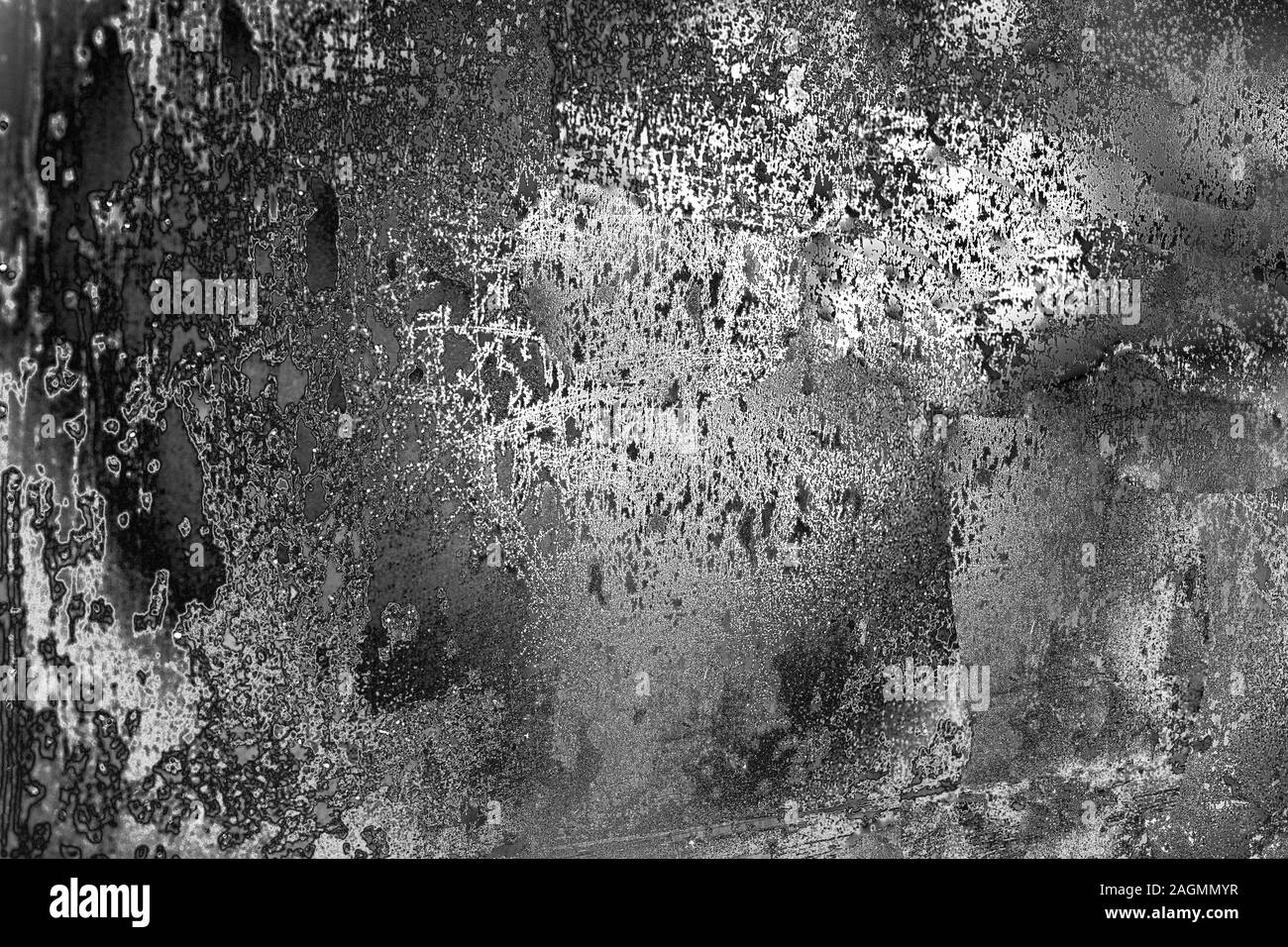 Abstract black and white aged grunge texture background, dark and light scratches, monochrome metallic backdrop, gray stained surface, frosty glass Stock Photo