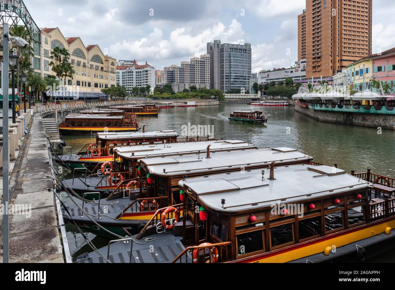 Tourist boats on the River Singapore at, Clarke Quay, Singapore Stock Photo