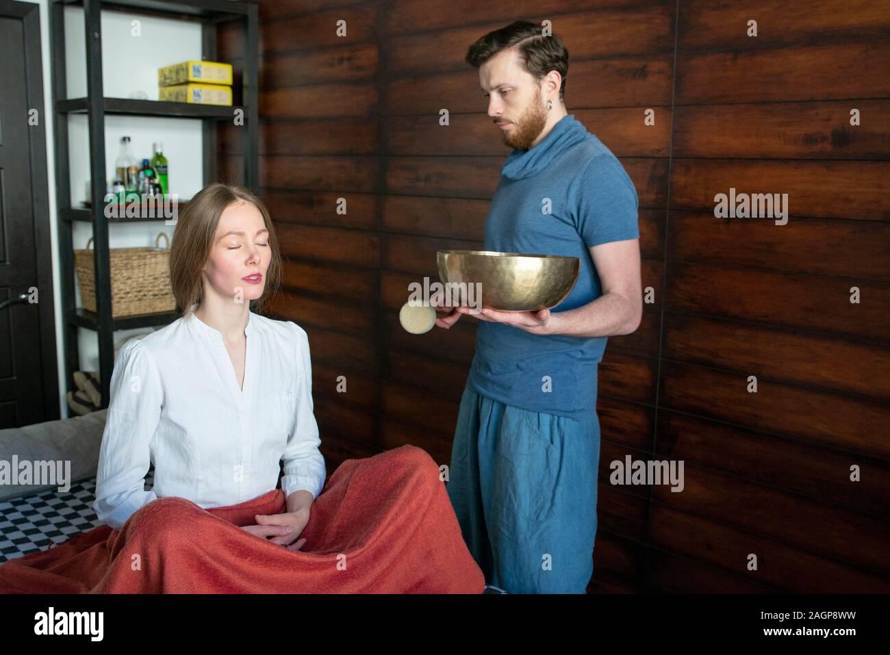 Tibetan singing bowl in sound therapy Stock Photo