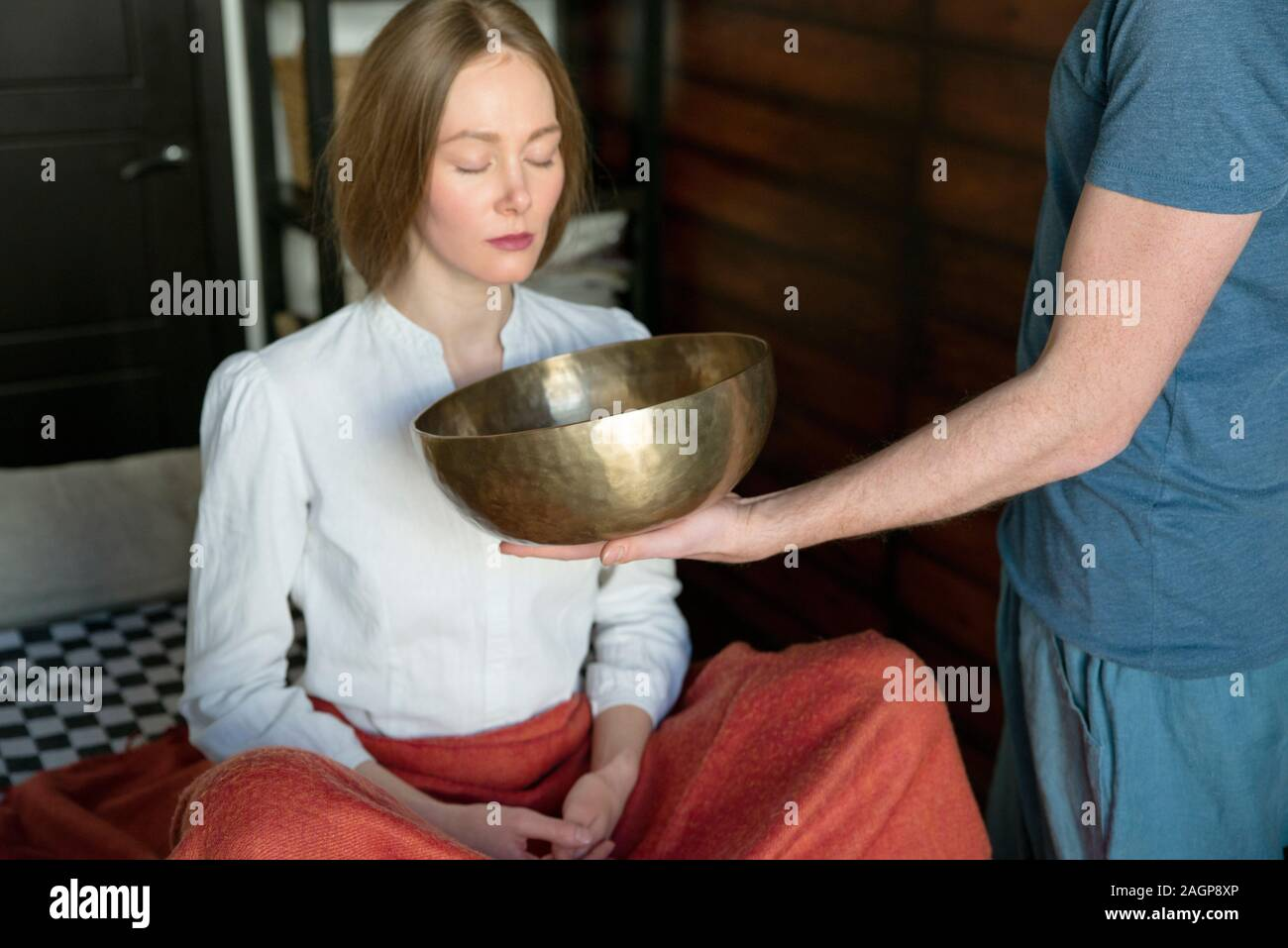 Tibetan singing bowl in sound therapy Stock Photo
