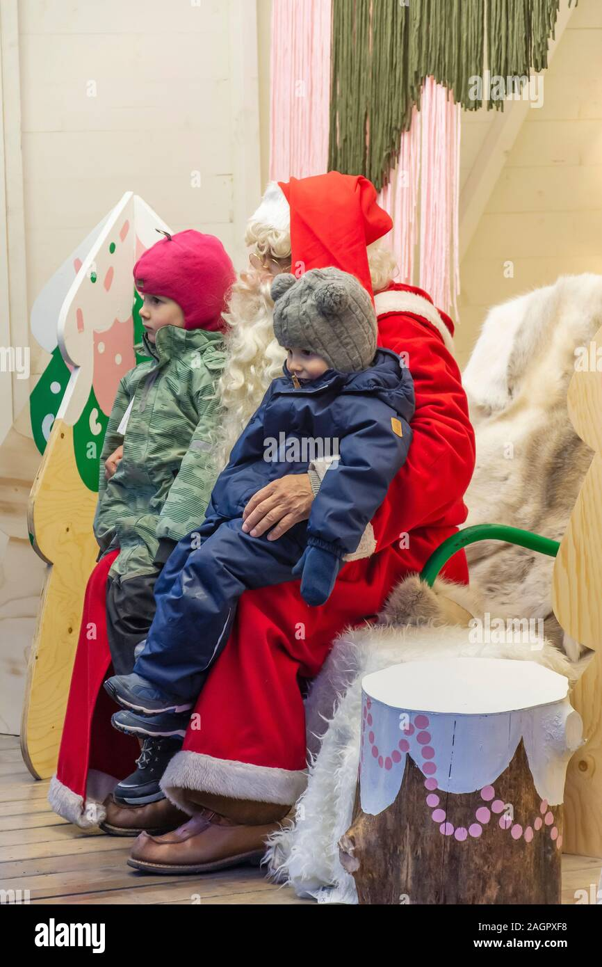 Two Children with Santa Claus at Senate Square in Helsinki Finland Stock Photo
