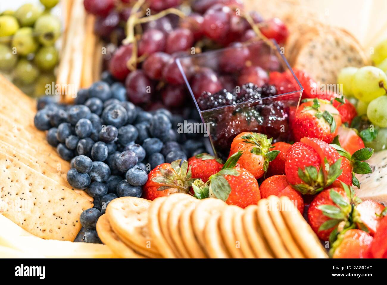 Gourmet Party Cheese Platter With Fruit Cheese And Crackers Stock Photo Alamy