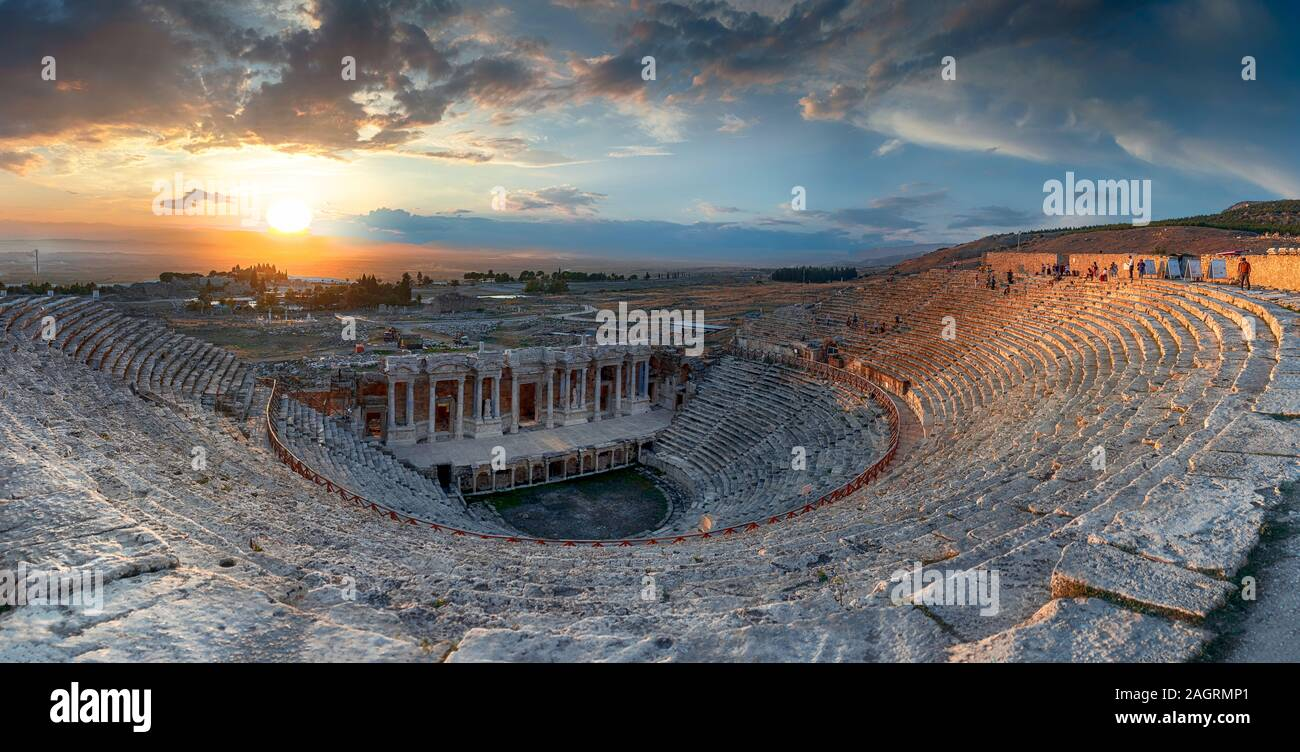 Amphitheater in ancient city of Hierapolis. Dramatic sunset sky. Unesco Cultural Heritage Monument. Pamukkale, Turkey Stock Photo