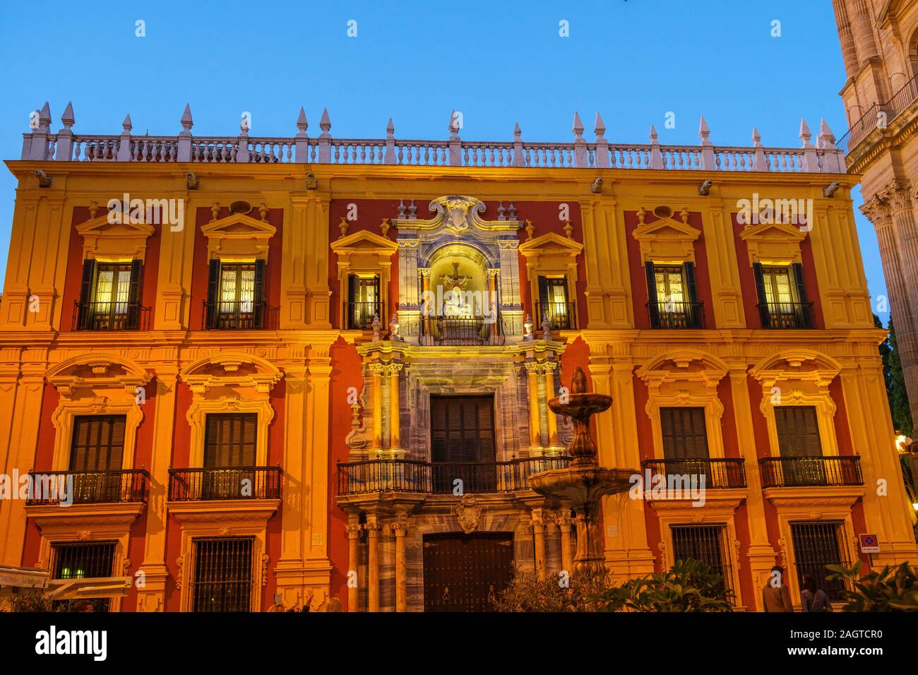 Religious building of the Episcopal palace at dusk, Málaga capital. Costa del Sol, Andalusia south of Spain. Europe Stock Photo