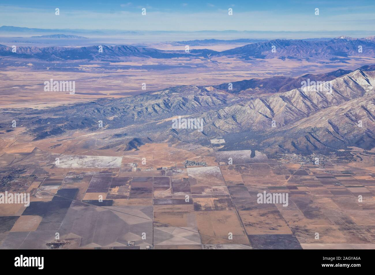 Rocky Mountains, Oquirrh range aerial views, Wasatch Front Rock from airplane. South Jordan, West Valley, Magna and Herriman, by the Great Salt Lake U Stock Photo