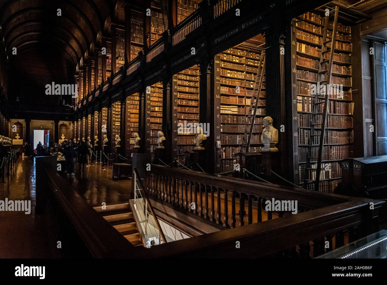DUBLIN, IRELAND, DECEMBER 21, 2018: The Long Room in the Trinity College Library, home to The Book of Kells. Perspective view of the place, with large Stock Photo