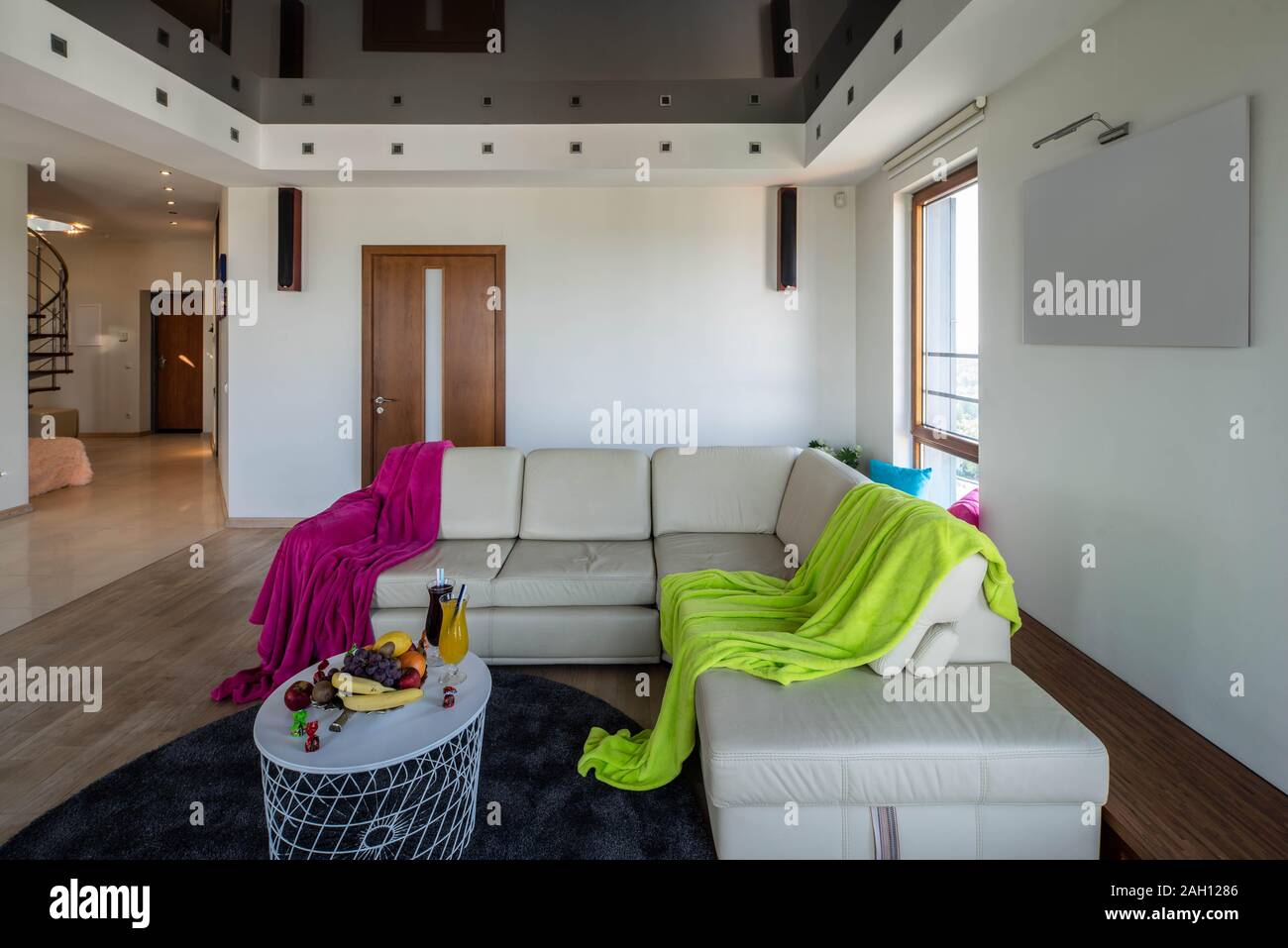 View Of Cozy Sofa And Small Table With Fruits And Drinks In Modern Luxury Apartment Stock Photo Alamy