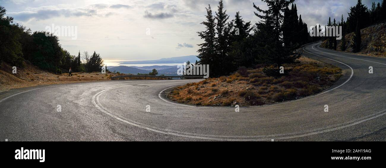 curving winding road through the pine forest of Zakynthos Island, Greece Stock Photo