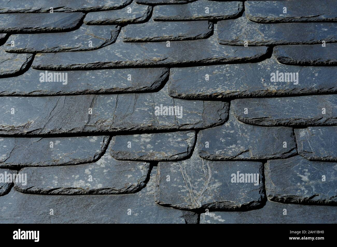 Rustic black slate roof texture. Stock Photo