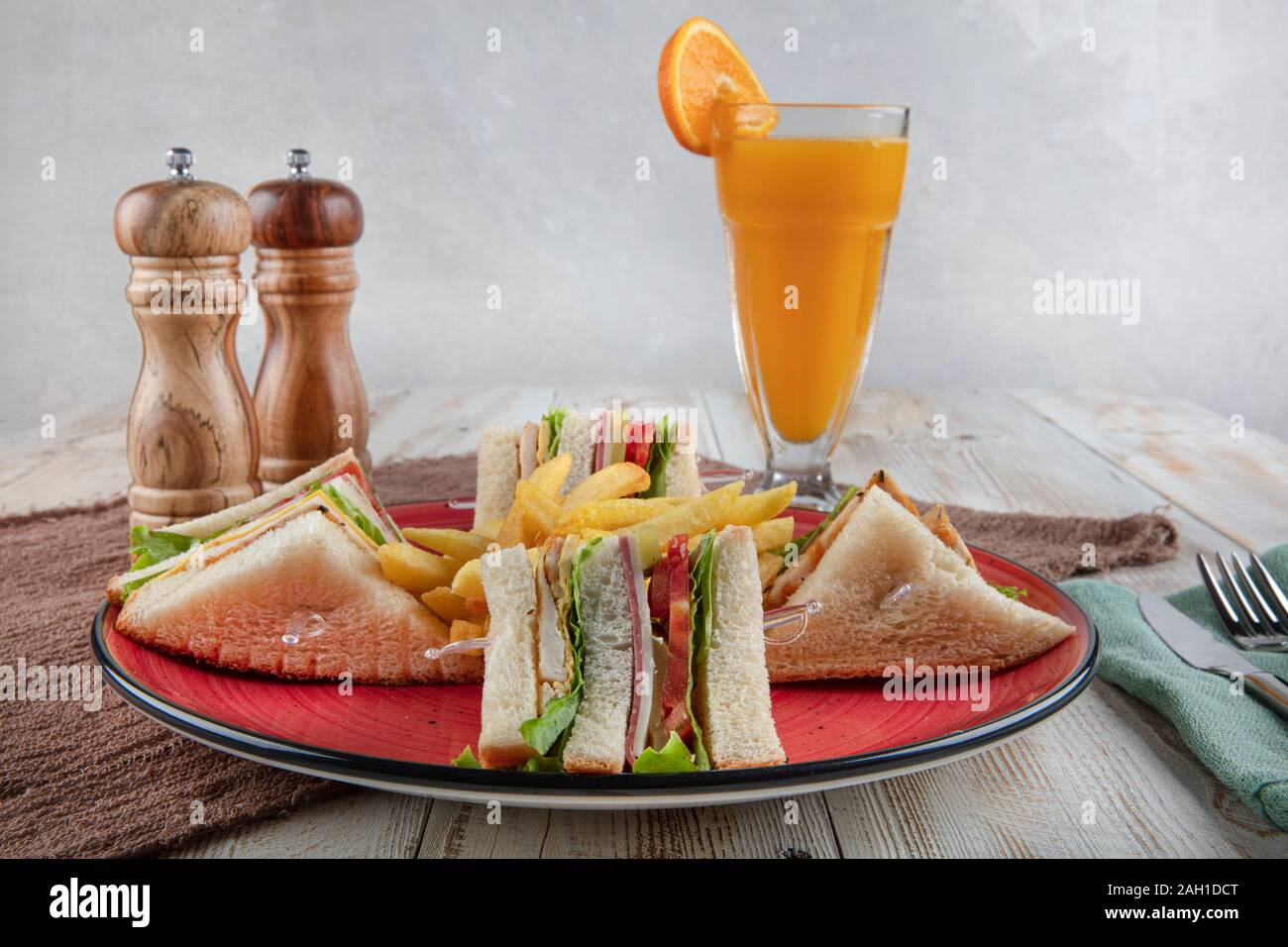 American Foods - Classic Club Sandwich with French Fries.  Club sandwich restaurant concept. Stock Photo