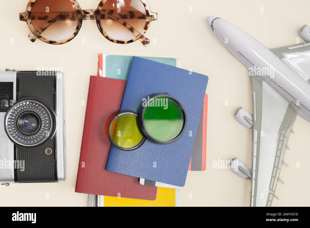 Going on vacation by plane, symbolic onjects shot from above. Travelling, exploring new countries, haveing international flights concept. Stock Photo