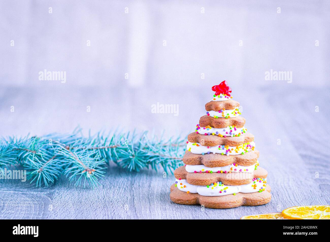 Alternative Christmas Tree Made From Ginger Cookies And Colored Sprinkles Next To Christmas Tree Branches On A Light Background Stock Photo Alamy